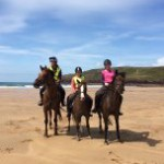 Freshwater West summer sand with visiting guests and their horses
