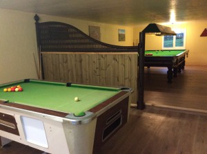 Full sized snooker table and small pool table in games room